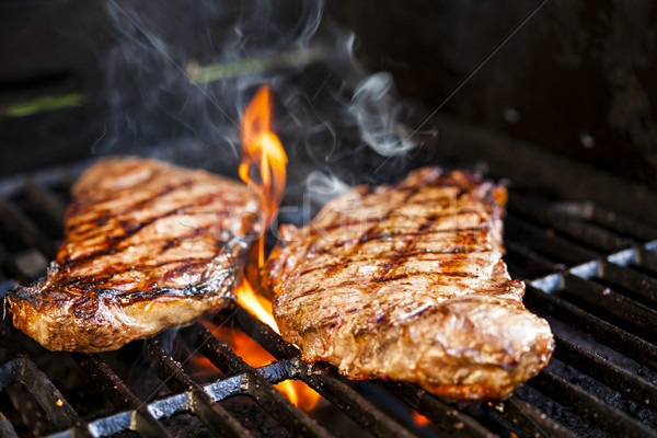 Steaks on barbecue Stock photo © elenaphoto