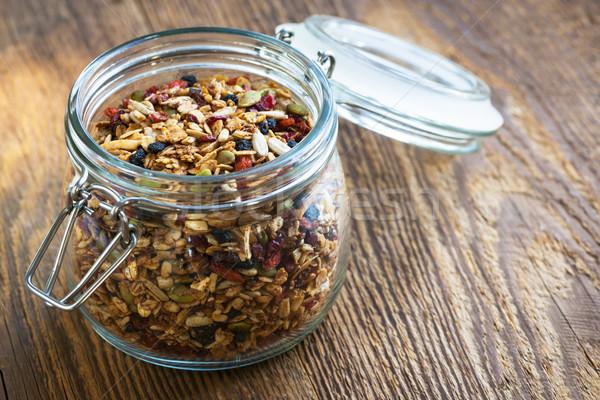 Homemade granola in open glass jar Stock photo © elenaphoto