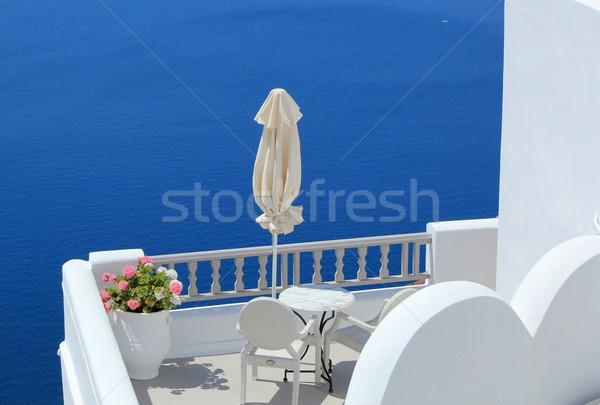 балкона морем Санторини Греция зонтик цветы Сток-фото © Elenarts