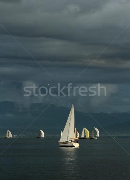 Sailing at sunset Stock photo © Elenarts