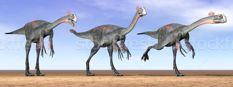 Stock photo: Gigantoraptor dinosaurs in the desert - 3D render