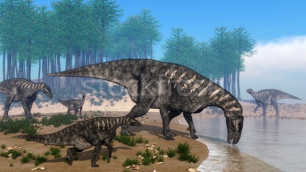 Iguanodon dinosaurs herd at the shoreline - 3D render Stock photo © Elenarts