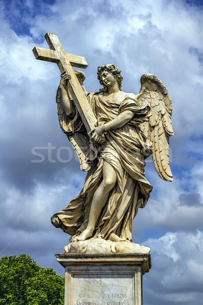 Angel with the Cross statue on the Ponte Sant' Angelo bridge, Rome, Italy Stock photo © Elenarts