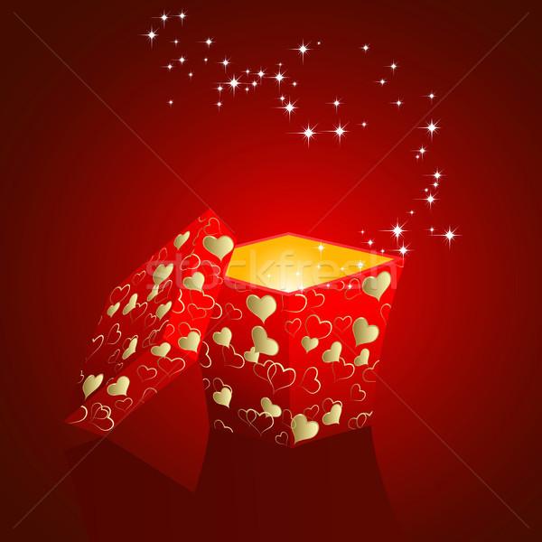 Hediye kutusu açmak hediye kutuları kırmızı kalpler Stok fotoğraf © ElenaShow