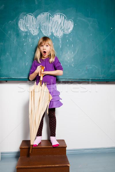 Meglepődött fiatal lány esernyő bent stúdió portré Stock fotó © ElinaManninen
