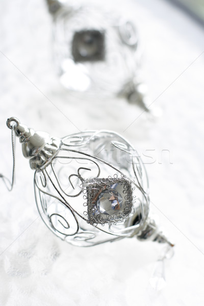 Sparkly silver colored Christmas baubles on glass table. Stock photo © ElinaManninen