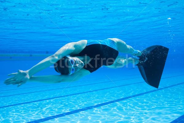 Kobiet pływanie podwodne basen sportu fitness Zdjęcia stock © ElinaManninen