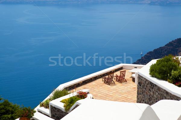 Pokład krzesła santorini Grecja spokojne sceny taras Zdjęcia stock © ElinaManninen