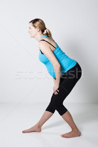Stock fotó: Terhes · nő · nyújtás · előad · láb · testmozgás · nő