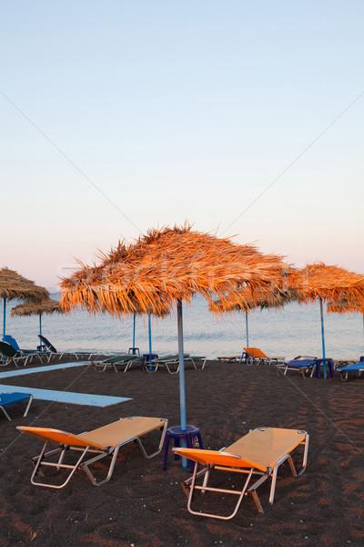 Santorin Grèce plage parapluies soleil Photo stock © ElinaManninen