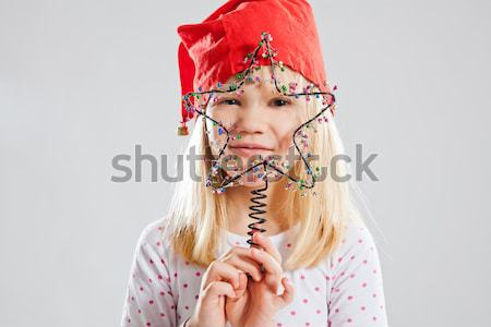 Smiling woman in knitted hat holding cup Stock photo © ElinaManninen