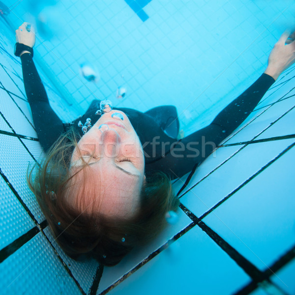 Kadın dalgıç gözleri kapalı sualtı yüzme havuzu yetişkin Stok fotoğraf © ElinaManninen
