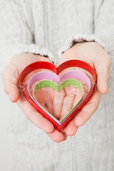 Serca symbolika ręce trzy kolorowy metal Zdjęcia stock © ElinaManninen