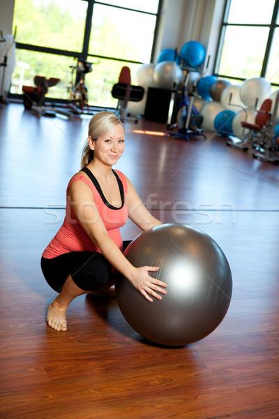 Pregnant women doing squatting exercise. Stock photo © ElinaManninen
