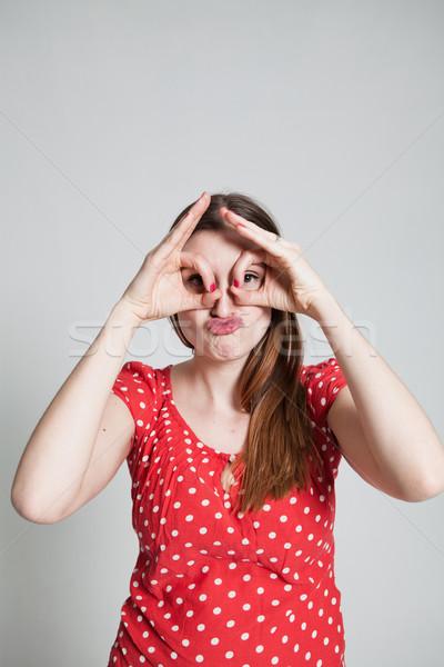 Vonzó nő néz ujj védőszemüveg stúdió portré Stock fotó © ElinaManninen