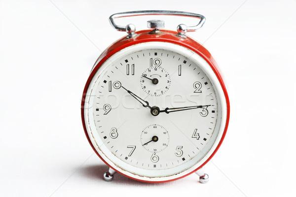 Old red analog alarm clock. Stock photo © ElinaManninen