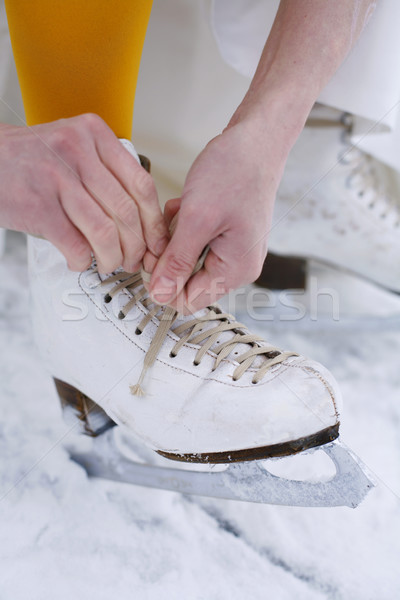 Putting on ice skates. Stock photo © ElinaManninen
