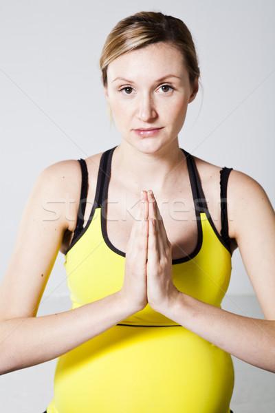 Stock fotó: Terhes · nő · meditál · kezek · együtt · nő · fitnessz