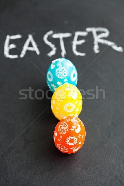 Colorido huevos de Pascua texto primer plano tres huevo de Pascua Foto stock © ElinaManninen