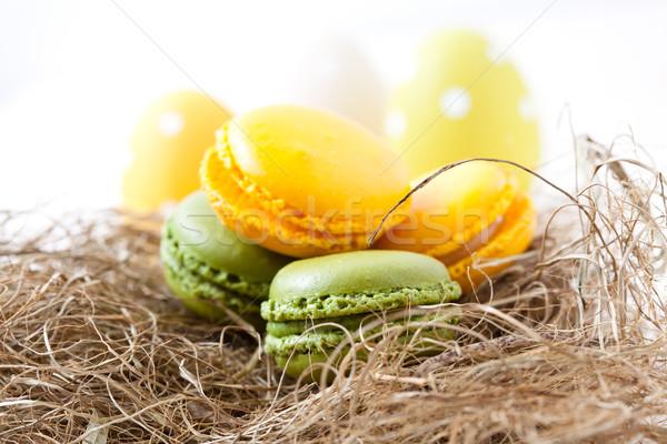 Colorido ovos de páscoa palha ninho Foto stock © ElinaManninen