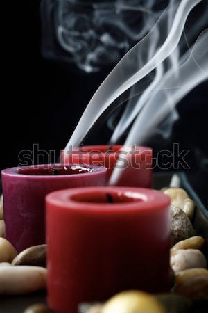 Extinguished candles in the dark. Stock photo © ElinaManninen