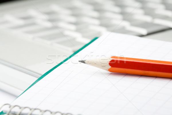 Pencil, notepad and laptop. Stock photo © ElinaManninen