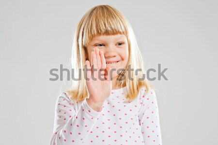 Smiling young girl showing hand signal Stock photo © ElinaManninen