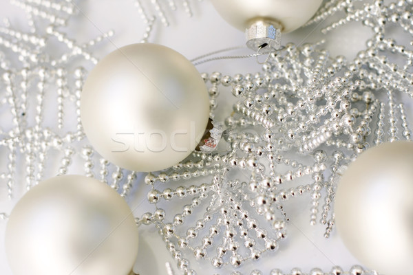 Silver colored Christmas baubles on glass table. Stock photo © ElinaManninen