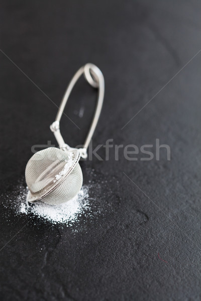 Sieve and icing sugar Stock photo © ElinaManninen