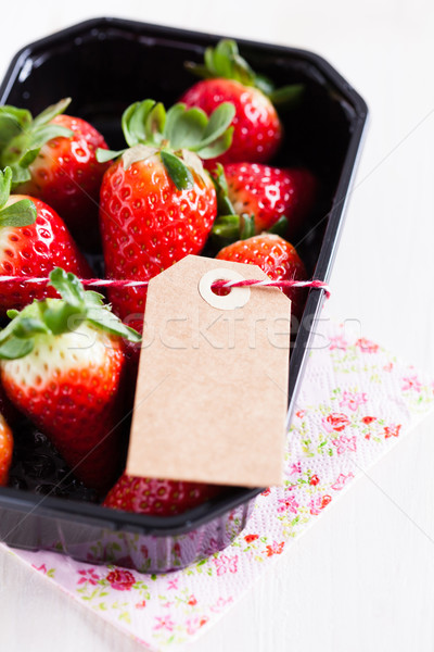 Fresh strawberries with tag Stock photo © ElinaManninen