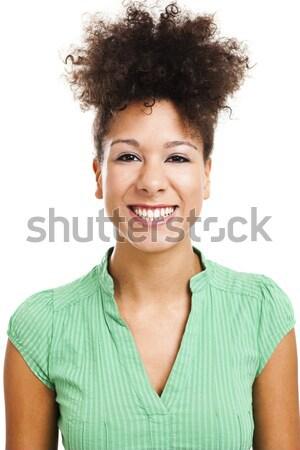 красивая женщина улыбаясь глядя камеры изолированный Сток-фото © ElinaManninen