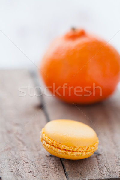 Macaroon and orange Stock photo © ElinaManninen