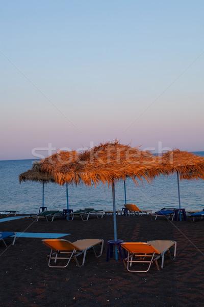 サントリーニ ギリシャ ビーチ 傘 日没 旅行 ストックフォト © ElinaManninen
