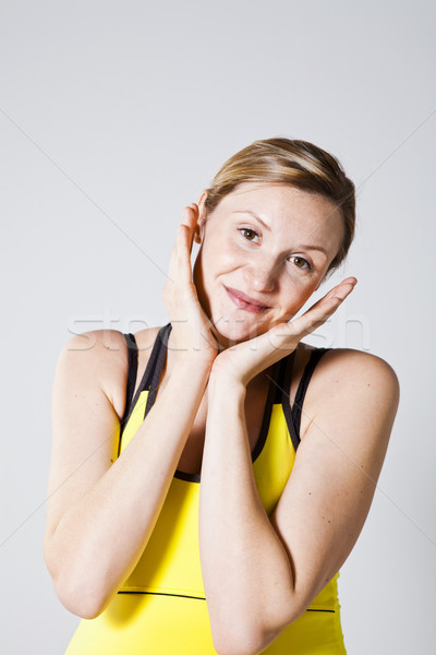 Portret kobieta w ciąży piękna ręce policzki kobieta Zdjęcia stock © ElinaManninen