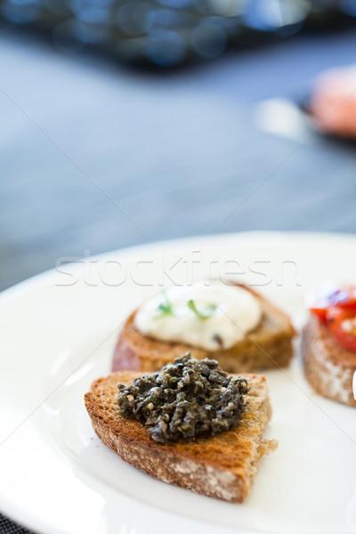 Bruschetta appetizers on plate Stock photo © ElinaManninen