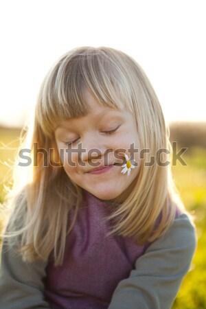 Kislány kint aranyos boldogtalan zöld mező Stock fotó © ElinaManninen