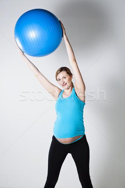 Kobieta w ciąży fitness piłka niebieski powyżej Zdjęcia stock © ElinaManninen