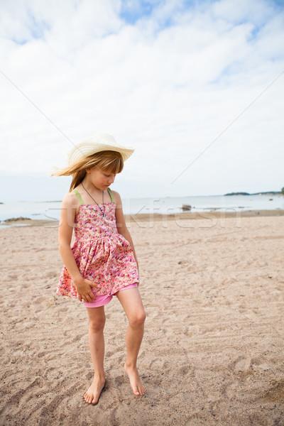 Genç yalınayak kız plaj Stok fotoğraf © ElinaManninen