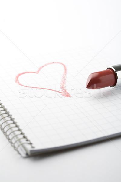 Lipstick and heart on notepad. Stock photo © ElinaManninen