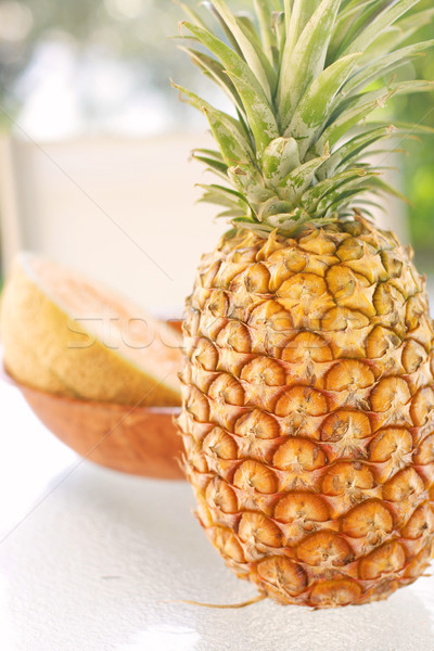 Colorful tropical fruit arrangement. Stock photo © ElinaManninen