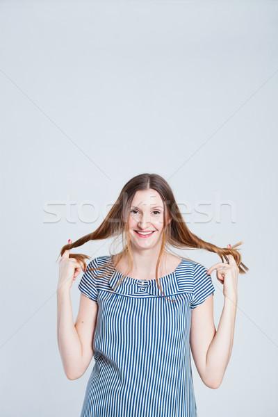 Boldog vonzó nő stúdió portré mosolyog vonzó Stock fotó © ElinaManninen