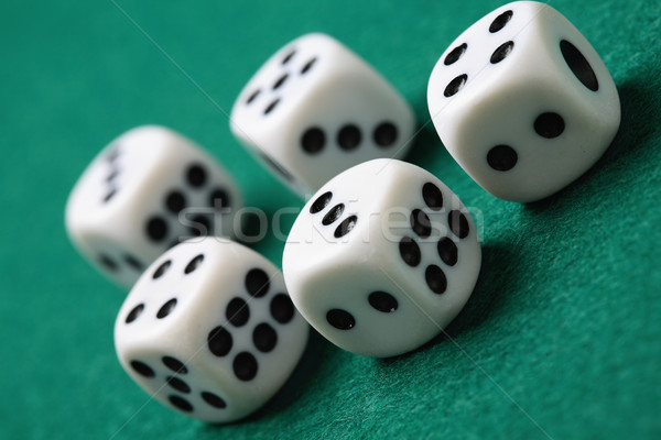 Gambling die on a green surface. Stock photo © ElinaManninen