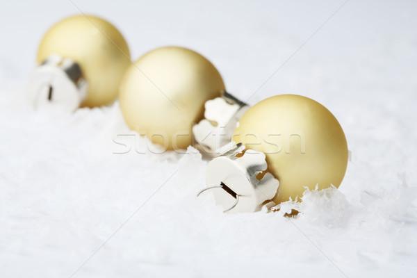 Gold Christmas bauble decorations. Stock photo © ElinaManninen