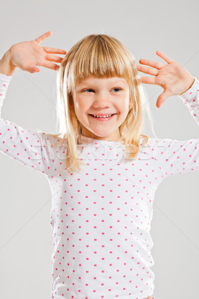 Feliz sorridente jovem as mãos levantadas estúdio retrato Foto stock © ElinaManninen