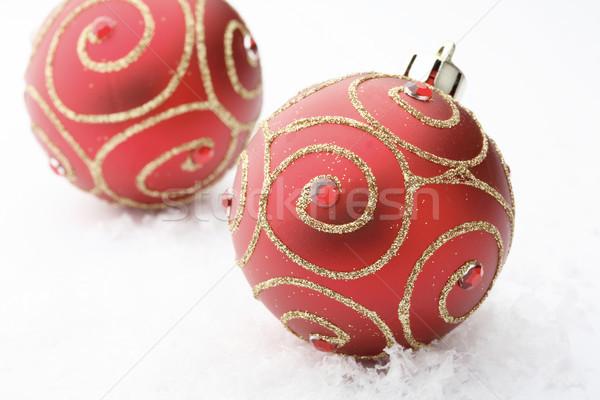 Czerwony christmas cacko dekoracje dwa Zdjęcia stock © ElinaManninen