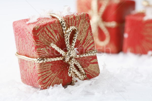 Karácsony ajándékok piros csomagolás dekoratív íjak Stock fotó © ElinaManninen