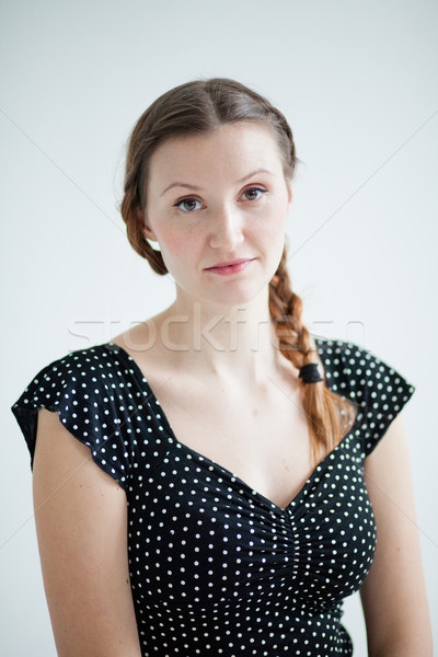 Portrait of relaxed looking attractive woman Stock photo © ElinaManninen
