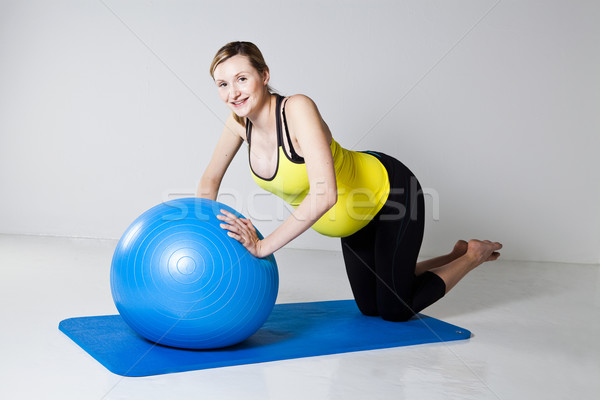 Pregnant woman doing push-up exercise Stock photo © ElinaManninen