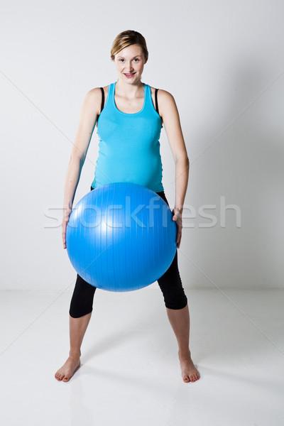 Hamile kadın uygunluk top mavi kadın Stok fotoğraf © ElinaManninen
