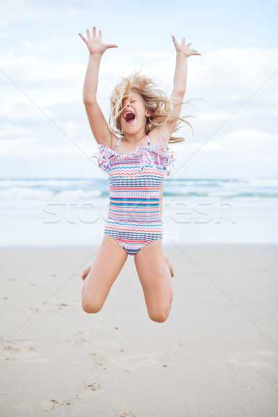 Young girl having fun at beach Stock photo © ElinaManninen
